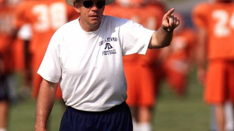 FILE - In this Aug. 9, 2000, file photo, Carson-Newman head coach Ken Sparks gives directions to his team during the football practice in Jefferson City, Tenn. Sparks, a football coach who won 338 games for Division II Carson-Newman to rank fifth on the NCAA's all-time list, died Wednesday, Mach 29, 2017, Carson-Newman athletic department spokesman Adam Cavalier said. He was 73. Sparks spent his entire 37-year head coaching career at Carson-Newman and went 338-99-2. (AP Photo/Wade Payne, File)