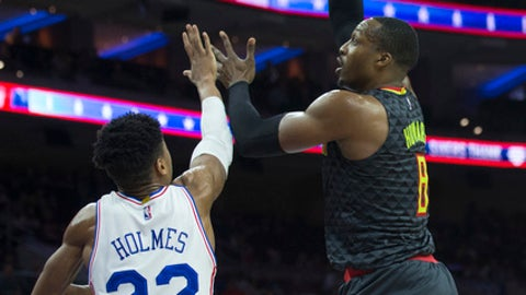 PHILADELPHIA, PA - MARCH 29: Dwight Howard #8 of the Atlanta Hawks shoots the ball against Richaun Holmes #22 of the Philadelphia 76ers in the first quarter at the Wells Fargo Center on March 29, 2017 in Philadelphia, Pennsylvania. NOTE TO USER: User expressly acknowledges and agrees that, by downloading and or using this photograph, User is consenting to the terms and conditions of the Getty Images License Agreement. (Photo by Mitchell Leff/Getty Images)