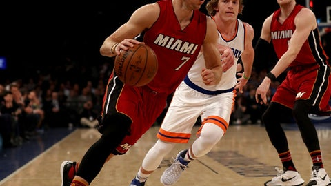 NEW YORK, NY - MARCH 29:  Goran Dragic #7 of the Miami Heat heads for the net as Ron Baker #31 of the New York Knicks defends at Madison Square Garden on March 29, 2017 in New York City. NOTE TO USER: User expressly acknowledges and agrees that, by downloading and or using this Photograph, user is consenting to the terms and conditions of the Getty Images License Agreement  (Photo by Elsa/Getty Images)