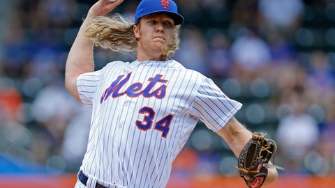 FILE - In this June 22, 2016, file photo, New York Mets starting pitcher Noah Syndergaard (34) delivers during the first inning of an interleague baseball game against the Kansas City Royals, in New York. With all those 100 mph fastballs flying through the strike zone these days from Aroldis Chapman, Noah Syndergaard and others, flame-throwers are the norm rather than the exception _ in rotations and bullpens alike. (AP Photo/Kathy Willens, File)