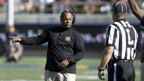 FILE - In this Sept. 5, 2015 file photo, Grambling State coach Broderick Fobbs, left, talks with an official during the second half of an NCAA college football game against Californiain Berkeley, Calif. Arizona host Grambling State on Saturday.  (AP Photo/Ben Margot, File)
