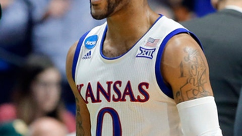 FILE - In this March 19, 2017, file photo, Kansas' Frank Mason III (0) celebrates a basket in the second half of a second-round game in the men's NCAA college basketball tournament in Tulsa, Okla. Mason was selected The Associated Press men's NCAA college basketball Player of the Year, Thursday, March 30, 2017. (AP Photo/Tony Gutierrez, File)