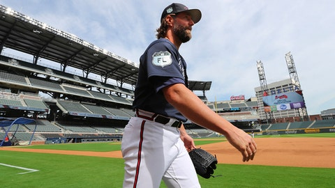 Atlanta Braves pitcher R.A. Dickey walks onto the field as the Braves hold the first workout in their new baseball stadium Thursday, March 30, 2017, at SunTrust Park in Atlanta. Curtis Compton/Atlanta Journal-Constitution via AP)