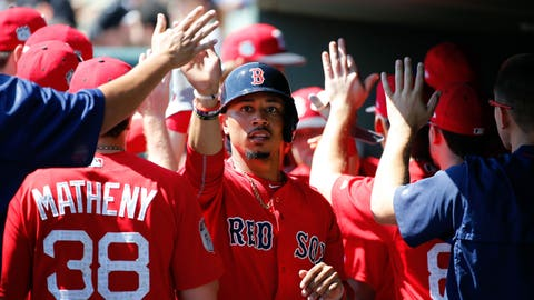 Mar 1, 2017; Sarasota, FL, USA; Boston Red Sox right fielder Mookie Betts (50) is congratulated in the dugout after he scored against the Baltimore Orioles at Ed Smith Stadium. Mandatory Credit: Kim Klement-USA TODAY Sports