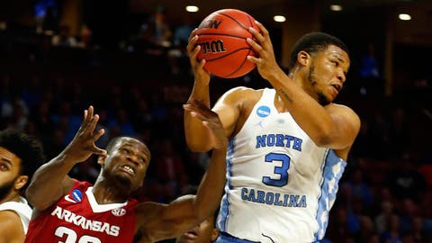 Mar 19, 2017; Greenville, SC, USA; North Carolina Tar Heels forward Kennedy Meeks (3) grabs a rebound against Arkansas Razorbacks forward Moses Kingsley (33) during the first half in the second round of the 2017 NCAA Tournament at Bon Secours Wellness Arena. Mandatory Credit: Jeremy Brevard-USA TODAY Sports