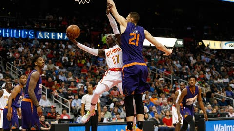 Mar 28, 2017; Atlanta, GA, USA; Atlanta Hawks guard Dennis Schroder (17) shoots the ball past Phoenix Suns center Alex Len (21) in the first quarter at Philips Arena. Mandatory Credit: Brett Davis-USA TODAY Sports
