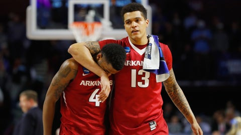 GREENVILLE, SC - MARCH 19:  Daryl Macon #4 and Dustin Thomas #13 of the Arkansas Razorbacks react after being defeated by the North Carolina Tar Heels 72-65 in the second round of the 2017 NCAA Men's Basketball Tournament at Bon Secours Wellness Arena on March 19, 2017 in Greenville, South Carolina.  (Photo by Gregory Shamus/Getty Images)