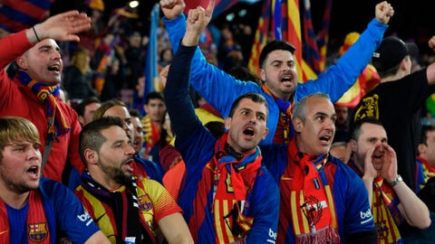 Barcelona' supporters cheer their team before the UEFA Champions League round of 16 second leg football match FC Barcelona vs Paris Saint-Germain FC at the Camp Nou stadium in Barcelona on March 8, 2017. / AFP PHOTO / LLUIS GENE        (Photo credit should read LLUIS GENE/AFP/Getty Images)