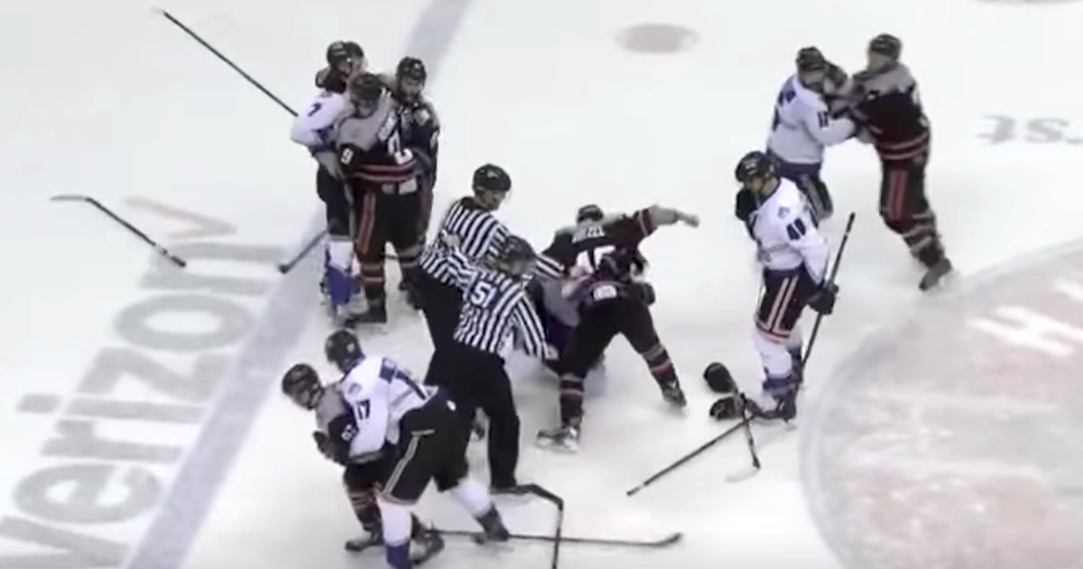 Hockey player deliberately shoots puck into opposing bench, sparks brawl | FOX Sports