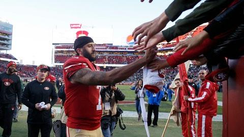 San Francisco 49ers quarterback Colin Kaepernick (7) greets fans after an NFL football game against the Seattle Seahawks in Santa Clara, Calif., Sunday, Jan. 1, 2017. (AP Photo/Tony Avelar)