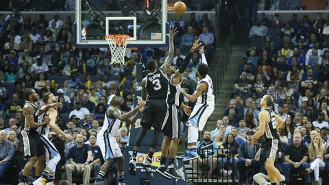 Mar 18, 2017; Memphis, TN, USA; Memphis Grizzlies guard Mike Conely (11) shoots over San Antonio Spurs center Dewayne Dedmon (3) in the second quarter at FedExForum. Mandatory Credit: Nelson Chenault-USA TODAY Sports