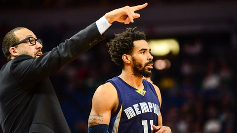 Feb 4, 2017; Minneapolis, MN, USA; Memphis Grizzlies head coach David Fizdale offers instructions with guard Mike Conley (11) during the fourth quarter against the Minnesota Timberwolves at Target Center. The Grizzlies won 107-99. Mandatory Credit: Jeffrey Becker-USA TODAY Sports