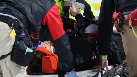 RALEIGH, NC - MARCH 27: Goaltender Eddie Lack #31 of the Carolina Hurricanes gives a thumbs up as he is stretchered off the ice following a collision on the final play of an NHL game against the Detroit Red Wings on March 27, 2017 at PNC Arena in Raleigh, North Carolina.  (Photo by Gregg Forwerck/NHLI via Getty Images)