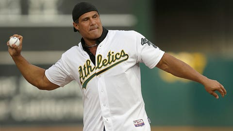 Former Oakland Athletics player Jose Canseco throws out the ceremonial first pitch prior to a baseball game against the Boston Red Sox, Saturday, Sept. 3, 2016, in Oakland, Calif. (AP Photo/Ben Margot)
