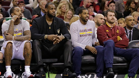FILE - In this April 13, 2016 file photo, Cleveland Cavaliers' J.R. Smith, LeBron James, Tristan Thompson and Kevin Love, from left, watch from the bench during the first half of the team's NBA basketball game against the Detroit Pistons, in Cleveland. While Golden State considers life without Stephen Curry and the Los Angeles Clippers deal with the loss of Chris Paul and Blake Griffin, the Cavs are healthy and resting up for the second round. (AP Photo/Tony Dejak, File)