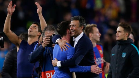 Barcelona's head coach Luis Enrique celebrates with Lionel Messi at the end of the Champions League round of 16, second leg soccer match between FC Barcelona and Paris Saint Germain at the Camp Nou stadium in Barcelona, Spain, Wednesday March 8, 2017. Barcelona won the match 6-1 (6-5 on aggregate). (AP Photo/Manu Fernandez)