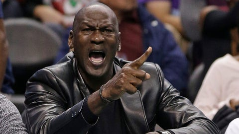 Charlotte Hornets owner Michael Jordan shouts at an official in the first half of an NBA basketball game against the Chicago Bulls in Charlotte, N.C., Friday, Dec. 23, 2016. (AP Photo/Chuck Burton)