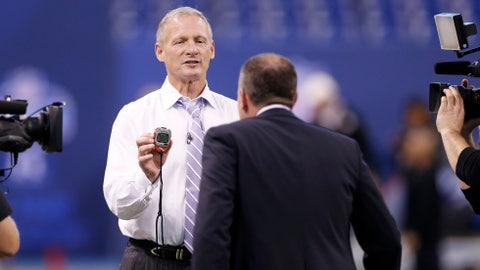 INDIANAPOLIS, IN - FEBRUARY 22: NFL Network draft expert Mike Mayock shows host Rich Eisen his time after running the 40-yard dash in a suit and tie during the 2015 NFL Scouting Combine at Lucas Oil Stadium on February 22, 2015 in Indianapolis, Indiana. (Photo by Joe Robbins/Getty Images)