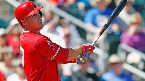 Los Angeles Angels center fielder Mike Trout watches the flight of the baseball during the first inning of a spring training baseball game against the Cincinnati Reds Wednesday, March 8, 2017, in Goodyear, Ariz. The Angels defeated the Reds 9-0. (AP Photo/Ross D. Franklin)