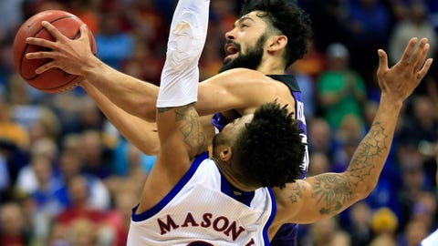 TCU guard Alex Robinson (25) over Kansas guard Frank Mason III (0) during second half of an NCAA college basketball game in the quarterfinal round of the Big 12 tournament in Kansas City, Mo., Thursday, March 9, 2017. TCU defeated Kansas 85-82. (AP Photo/Orlin Wagner)