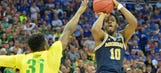 Michigan's incredible journey ends as Walton's last shot comes up short