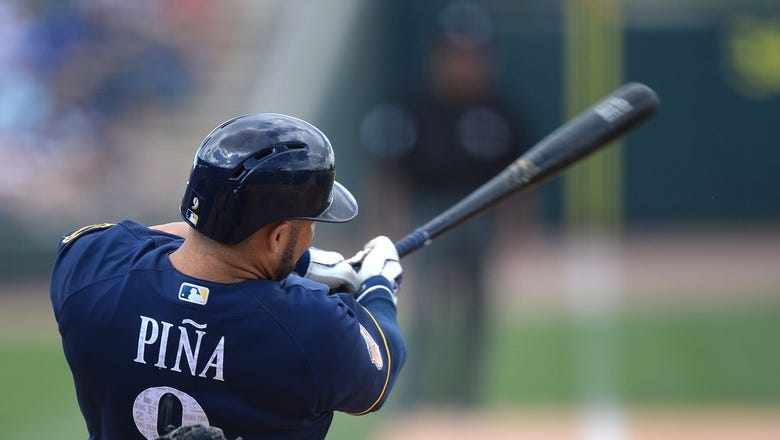Pina hits 4th homer of spring, but Brewers fall to Reds