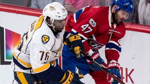 Nashville Predators defenseman P.K. Subban (76) and Montreal Canadiens' Alexander Radulov (47) meet in the corner during the second period of an NHL hockey game, Thursday, March 2, 2017 in Montreal.  (Paul Chiasson/The Canadian Press via AP)