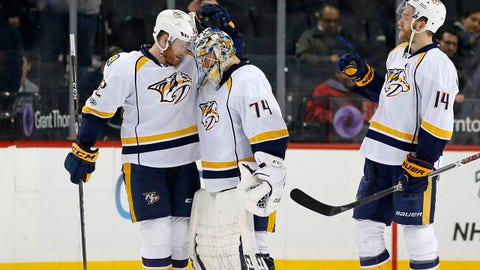Nashville Predators defenseman Matt Irwin (52) congratulates Predators goalie Juuse Saros (74) of Finland after the Predators defeated the Islanders 3-1 in an NHL hockey game in New York, Monday, March 27, 2017. Nashville Predators defenseman Mattias Ekholm (14) of Sweden stands by, right. (AP Photo/Kathy Willens)