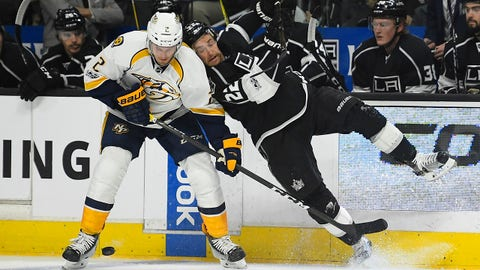 Nashville Predators defenseman Anthony Bitetto, left, and Los Angeles Kings center Trevor Lewis collide during the first period of an NHL hockey game, Thursday, March 9, 2017, in Los Angeles. (AP Photo/Mark J. Terrill)