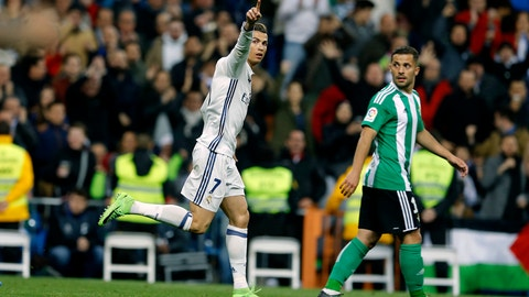 Real Madrid's Cristiano Ronaldo, left, celebrates after scoring his side's first goal against Real Betis during a Spanish La Liga soccer match between Real Madrid and Real Betis at the Santiago Bernabeu stadium in Madrid, Sunday, March 12, 2017. (AP Photo/Francisco Seco)