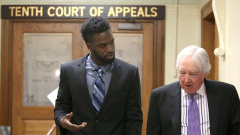 Former Baylor football player Sam Ukwuachu, left, leaves the 10th Court of Appeals with his attorney, William Bratton III, following arguments Wednesday, March, 1, 2017, in Waco, Texas. Ukwuachu is waiting on a ruling for a new trial after his conviction in 2015 for the rape of a woman. (Jerry Larson/Waco Tribune Herald via AP)