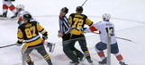 Linesman leaves game after being bowled over by Penguins player