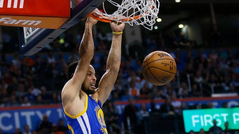 Golden State Warriors guard Stephen Curry dunks during the first quarter of an NBA basketball game against the Oklahoma City Thunder in Oklahoma City, Monday, March 20, 2017. (AP Photo/Sue Ogrocki)