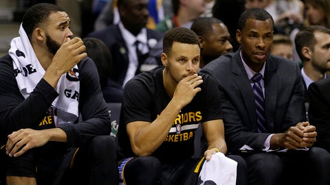Golden State Warriors' Stephen Curry, middle, watches from the bench during the second half of an NBA basketball game against the Milwaukee Bucks Saturday, Nov. 19, 2016, in Milwaukee. (AP Photo/Aaron Gash)