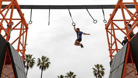 "VENICE BEACH, CA - JANUARY 12:   An athlete crosses the ""Kong"" obstacle during the Tough Mudder's ""Mudder Beach"" Event, which included workouts presented by Merrell and new 2017 obstacles at Muscle Beach on January 12, 2017 in Venice Beach, California. (Photo by Donald Miralle/Getty Images)"