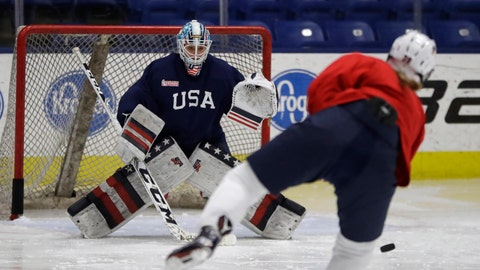 Team USA hockey goalie goalie Alex Rigsby takes a shot on goal during a practice session in Plymouth Township, Mich., Thursday, Dec. 15, 2016.  One of the best rivalries on ice, the U.S. and Canadian women, will resume their highly competitive hockey series this weekend in suburban Detroit. Unlike the NHL players, the world knows the best women hockey players will be competing for gold in South Korea in about 14 months. (AP Photo/Carlos Osorio)