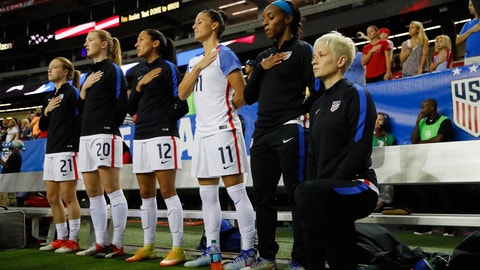 ATLANTA GA- SEPTEMBER 18 Megan Rapinoe #15 kneels during the National Anthem prior to the match between the United States and the Netherlands at Georgia Dome