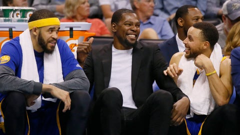 Golden State Warriors center JaVale McGee, left, injured forward Kevin Durant, center, and guard Stephen Curry, right, laugh on the bench during the fourth quarter of the team's NBA basketball game against the Oklahoma City Thunder in Oklahoma City, Monday, March 20, 2017. Golden State won 111-95. (AP Photo/Sue Ogrocki)