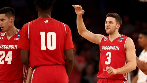 NEW YORK, NY - MARCH 24:  Zak Showalter #3 of the Wisconsin Badgers high-fives Nigel Hayes #10 in the first half against the Florida Gators during the 2017 NCAA Men's Basketball Tournament East Regional at Madison Square Garden on March 24, 2017 in New York City.  (Photo by Elsa/Getty Images)