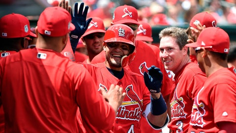 Mar 26, 2017; Jupiter, FL, USA; St. Louis Cardinals catcher Yadier Molina (center) celebrates with teammates after hitting a solo home run against the Miami Marlins during a spring training game at Roger Dean Stadium. Mandatory Credit: Steve Mitchell-USA TODAY Sports