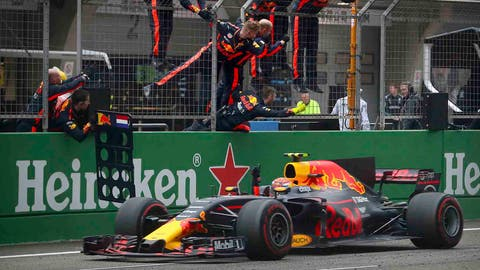 Max Verstappen celebrates his third-place finish at the Chinese GP. (AP Photo/Mark Schiefelbein)