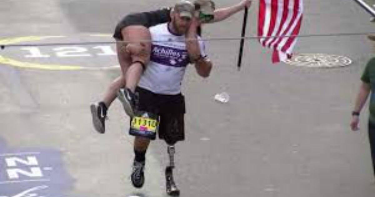 Army vet running with prosthetic leg carries woman across Boston Marathon finish line | FOX Sports