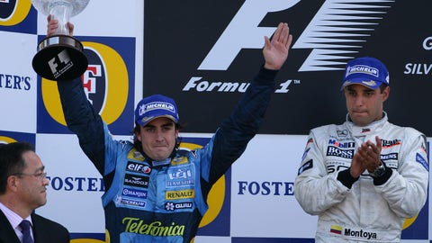 Fernando Alonso and Juan Pablo Montoya seen on the F1 podium in 2005. (Photo: Steve Etherington/LAT Photographic)