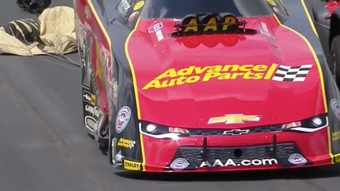 Damage on the side of Courtney Force's Funny Car following her crash at zMAX Dragway.