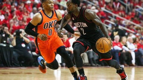 Apr 16, 2017; Houston, TX, USA; Houston Rockets guard Patrick Beverley (2) dribbles the ball as Oklahoma City Thunder guard Russell Westbrook (0) defends in game one of the first round of the 2017 NBA Playoffs at Toyota Center. Mandatory Credit: Troy Taormina-USA TODAY Sports