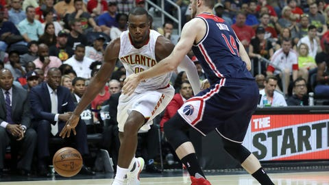 Apr 22, 2017; Atlanta, GA, USA; Atlanta Hawks forward Paul Millsap (4) drives against Washington Wizards forward Jason Smith (14) in the fourth quarter of game three of the first round of the 2017 NBA Playoffs at Philips Arena. The Hawks won 116-98. Mandatory Credit: Jason Getz-USA TODAY Sports