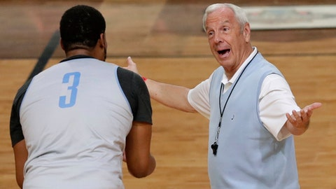 North Carolina head coach Roy Williams, right, talks with forward Kennedy Meeks during a practice session for their NCAA Final Four tournament college basketball semifinal game Friday, March 31, 2017, in Glendale, Ariz. (AP Photo/Matt York)