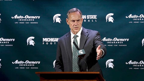 FILE - In this March 28, 2017 file photo, Michigan State coach Mark Dantonio speaks during an NCAA college football news conference at Spartan Stadium, in East Lansing, Mich. Michigan State will play a spring football game Saturday, April 1, 2017. The question is: Why? (Dale G Young/Detroit News via AP, File)
