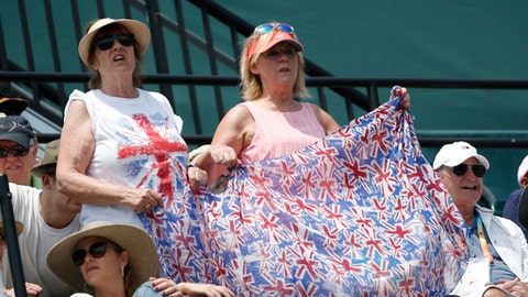 Fans of Johanna Konta, of Britain, cheer during Konta's women's singles final tennis match against Caroline Wozniacki, of Denmark, at the Miami Open, Saturday, April 1, 2017 in Key Biscayne, Fla. (AP Photo/Wilfredo Lee)