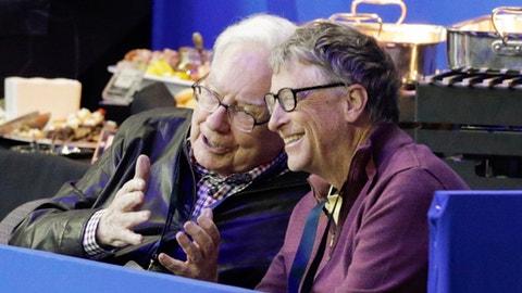 Bill Gates, right, and Warren Buffett talk during a break in the FEI World Cup equestrian jumping grand prix in Omaha, Neb., Saturday, April 1, 2017. Jennifer Gates, daughter of Bill Gates, is one of the contestants. (AP Photo/Nati Harnik)